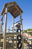 Park with jungle jim. A park next to the beach with a play area for kids containing a wooden jungle-jim Stock Photos