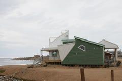 Park-Kanada-Gebäude in der Gemeinschaft von Qikiqtarjuaq, Nunavut Stockfotografie