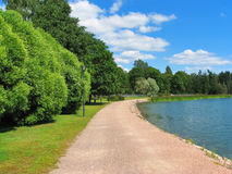 Park with lake. Summer scenic view of the park with lake stock photography