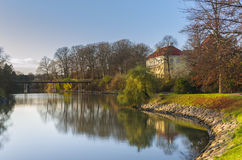 Park lake in autumn. Autumn landscape with bridge over small lake in the park and trees reflected in the water in Slottsparken, Malmo, Sweden Stock Photography