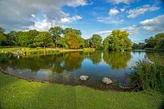 Park with lake, Birmingham, England Royalty Free Stock Image