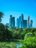 Nature and modern city on the horizon, futurism and utopia. Park with lake in the city, the concept of urbanism and nature, an oasis royalty free stock photos