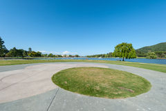 Park with lake, fountains tree and grass Stock Photo