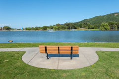 Park with lake, fountains tree and grass Stock Images