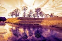 Park and lake near the Kastellet fortress. Copenhagen, Denmark. Orange and purple toned stock image