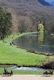 The park and lake in Vizille, from the castle. VIZILLE, FRANCE, March 31, 2018 : The castle park is the most popular site in the Isere region and a historic Stock Photo