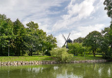 Park with lake and windmill Royalty Free Stock Images