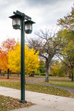 Park Lamp. This is a street lamp in the Minnehaha Park in Minneapolis, Minnesota. This was taken during autumn Royalty Free Stock Image