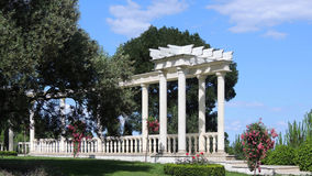 Park landscape. The white building in the classical style in the Seaside Park in Crimea. White terrace in the Park Paradise on the Crimea peninsula in Partenit Royalty Free Stock Photo