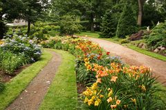 Park Lane. A lane running through a park and alongside flower beds stock photo