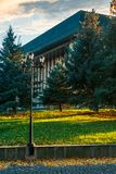 Park lantern near the Uzhgorod Drama Theater. Lovely urban scenery at sunrise in autumn Stock Photos