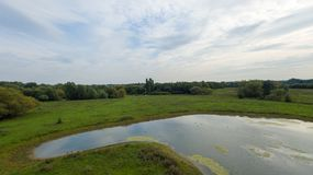 A park at late September, view of a lake at late afternoon Royalty Free Stock Photo