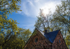Park lodge in the sunlight. The lodge is located in a park near Oranienbaum, in the town of Lomonosov, Russia Royalty Free Stock Image