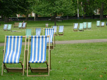 Park in London. A colourful deck chairs in London park royalty free stock images