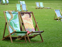 Park in London. A colourful deck chairs in St James park at London stock photos