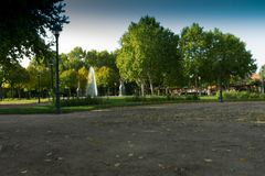 Park with a lot of colorful vegetation and water fountain stock photo