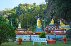 Park with lots of Buddha statues near sacred Kaw Ka Thawng Cave. In Hpa-An, Myanmar Stock Image