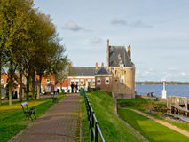 Park and medieval gatehouse tower next to Veere lake in the Netherlands Stock Images