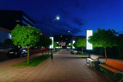 Park at Modern shopping center building at night. Park at the Modern shopping center building concept. Street, late at night stock photos