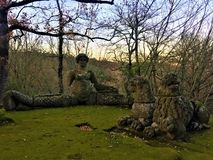 Park of the Monsters, Sacred Grove, Garden of Bomarzo. Lion and lioness rest with a siren stock photography