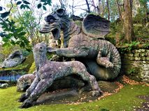 Park of Monsters, Sacred Grove, Garden of Bomarzo. Dragon with Lions and fascination. Park of Monsters, Sacred Grove, Garden of Bomarzo, a Manieristic monumental royalty free stock photos