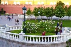 Park near the Kremlin. Lantern, bushes and white historical railing Royalty Free Stock Photos