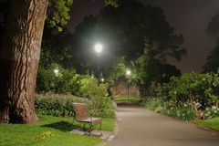 In the park at night. Wooden bench in the park at Night Royalty Free Stock Photo