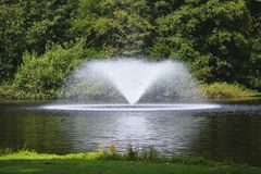 The fountain on a pond... royalty free stock photo