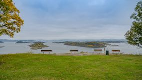 A park in Oslo with four benches for sigtseeing during Autumn with Oslo fjord. In Background,Oslo, Norway Stock Photos