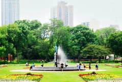 The park outside of Lincoln Park Conservatory in Chicago, Illinois. A statue and fountain in the park outside the Lincoln Park Conservatory in Chicago, Illinois Stock Photos