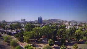 Park overflight towards buildings stock video footage