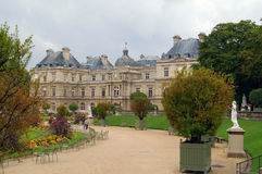 Park in paris jardin luxembourg. Park with flowers and alley in paris france jardin luxembourg palace building in background summer day overcast Stock Image