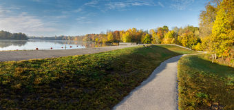 Park Path. Recreational path winding past lake with fall colors and blue sky goshen indiana Royalty Free Stock Image