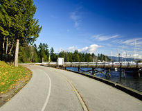 Park Pathway on Water. Park Pathway near the water and a marina Stock Photography