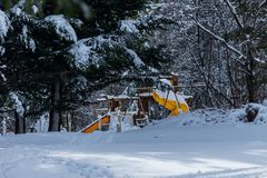 Park play place covered in a thick layer of snow. Park play place covered in a thick white layer of snow royalty free stock image