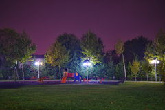 Park with playground in the night Stock Photography