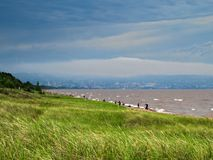 Park Point Beach on Lake Superior with Duluth, Minnesota under cloudy skies stock photography