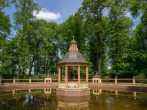 Park with the pond. Alcove in the middle of the pond in the park Stock Photo