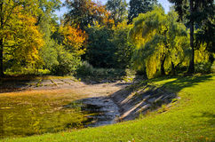 Park with pond during autumn. Town park with pond during colorful autumn Royalty Free Stock Images