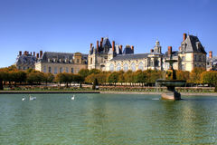 Park with pond of Fontainebleau palace in France Stock Images