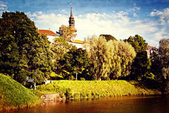Park with pond in old european city Stock Photos