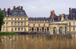 Park, pond and the palace of Fontainebleau Stock Photography