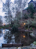 Park pond with theatre building at dawn Royalty Free Stock Photos