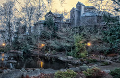 Park pond with theatre building at dawn Stock Photography