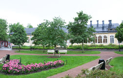 Park at rainy day in the historic quarter of Naantali, Finland.  Stock Photo