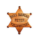 Park Ranger Badge. Yellowstone Park Ranger badge with Peter name, isolated on white Stock Photography