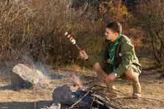 Park ranger cooking sausages Stock Photos