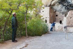 Park Ranger looking at mother and son visiting Cliff Palace in Mesa Verde National Park royalty free stock image