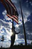 Park Ranger raising American Flag Stock Photos