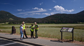 Park rangers helping tourists. Park rangers at the Rocky Mountain National Park, Colorado, USA Royalty Free Stock Photography